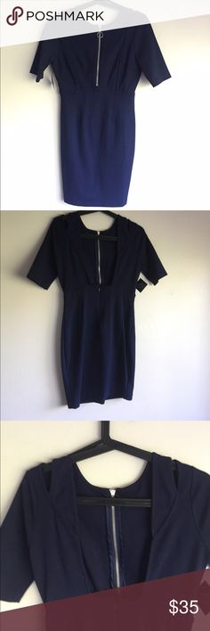 Nasty Gal Navy Blue Dress w/ Front Zipper Nasty Gal Navy Blue dress with front zipper and cut out details,  66% Rayon, 30% Nylon, 4% Spandex. Made in USA. Hand Wash Cold. Never worn, initially bought for a party, never tried on. Nasty Gal Dresses Midi