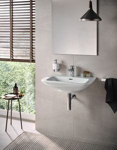 TOTO Wall-Hung Lavatories create a modern and open concept bathroom design. Diy Bathroom Remodel, Bathroom Renos, Master Bathroom, Design Bathroom, Masculine Bathroom, Natural Fiber Rugs, Bathroom Goals, Interior Design, Faucets