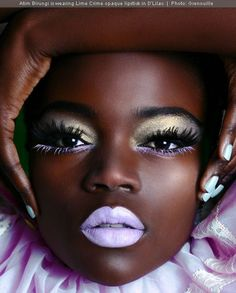 This is how pastel is suppose to look on skin! The contrast just pops on her gorgeous dark skin.
