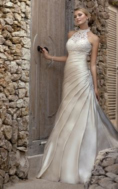Modern and vintage wedding gown with Dolce Satin and lace sweetheart neckline. Exclusive designer vintage wedding gown by Stella York.