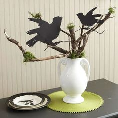 Tree branches with peat moss for leaves & crows cut from black card stock.