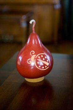 Paprika in color, comes with an electric light. Approximately 5 1/2 inches in diameter. Each piece is signed by one of our master crafters.
