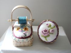 Hand woven baskets with needle felted pincushions by LARA LAWRENCE