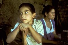 El Salvador. Son and mother in home