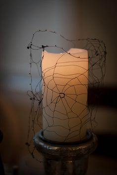 Spooky wire spider web candle cover