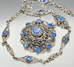 ON HOLD Antique Austro Hungarian Victorian sterling silver opal moonstone pendant necklace! Each bezel set luminous cabochon moonstone shimmers and glows a blue green with movement with the pendant a