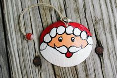 Hand Painted Seashell made to look like Santa Clause. Perfect Nautical themed Christmas Ornament!