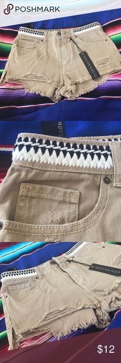 Perfect distressed booty shorts Brand new with tags, they were too small for me and I never had time to return them 😭. The braided waste is super cute and stylish for the summer. Perfect distressed feel with little slits on the side of the thigh. *LISTED FOR EXPOSURE.* Free People Shorts Jean Shorts