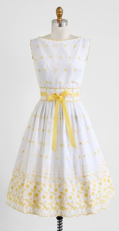 Darling vintage early 1960s dress.    ✧ by Jeanne D'arc ✧ sheer white cotton blend with yellow floral embroidery ✧ bodice is lined + skirt is unlined (both are sheer)  ✧ yellow silky ribbon woven at the waist  ✧ zips up the back with a covered metal zipper + hook    What an adorable