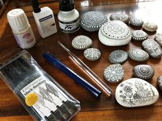 Painting on rocks: Black Faber Castell Pitt artist pens and white Pergamano indelible drawing ink are waterproof.