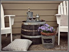 I'm getting ready to make a patio in the front with adirondack chairs and a whiskey barrel table!