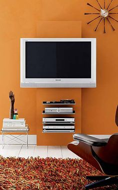 """Between the frame and panel, there's a space that holds cables and hides them from view. Furthering the clean look of cable management are slots at the back of each 17.5"""" x 13.75"""" shelf. The Muro Media Storage system is suitable for televisions 36"""" (min) to 50"""" (max) wide, weighing up to 100 lbs. Each shelf has a weight capacity of 12 lbs. In keeping with the do-it-yourself ethic, the holes for the screws on the front of the Muro are left exposed. . Made in Italy."""