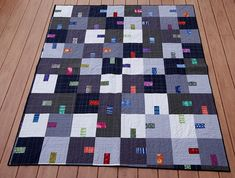 "Tempest Quilt by Orangebird242, via Flickr  using the Cherry House ""Tempest"" pattern.   The solids are Kona grays and navy blue. The prints are from Marcia Derse's ""Gerta"" and ""Streamline"" collections."