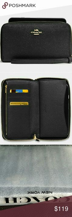 """COACH PHONE WALLET AUTHENTIC COACH PHONE WALLET  COLOR:BLACK/LIGHT GOLD   Details:  ●Crossgrain leather ●Six credit card slots ●Zip coin pocket  ●Inside phone compartment ●Zip-around closure ●Wrist strap attached ●6 1/4"""" (L) x 3 3/4"""" (H) x 3/4 (W)  BRAND NEW, WITH TAGS AND IN ORIGINAL PACKING. Coach Bags Wallets"""