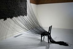 Its Not My Fault | 2011 1,346 sheets of Artist made paper, 1,346 nails, 1,346 strings, chair, scissors