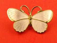 WHITE ENAMEL BUTTERFLY BROOCH, sterling silver