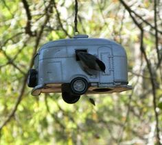 Airstream travel trailer birdhouse..  Faith says i need one of these, then i will quit trying to downsize :)