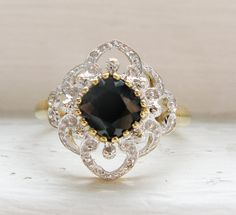 Hey, I found this really awesome Etsy listing at http://www.etsy.com/listing/160708487/vintage-elegant-sapphire-and-diamond