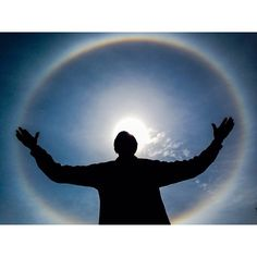 """""""A sun dog forms over the statue of president Nelson Mandela at the union Buildings Pretoria on Good Friday."""""""