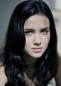 Grey Blue Eyes Black Hair Wavy Female Shoulders Up Portrait