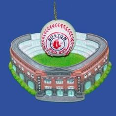 """$8.68-$12.00 The perfect item for any die-hard Boston Red Sox fan, this 3-3/4-Inch bas-relief flat back resin ornament is a miniature, detailed replica of Fenway Park, complete with the specific architecture of the stadium, the green of the field, and the stands. Above the field is a classic baseball with the Boston Red Sox logo on the front. Above the entrance to the stadium is a """"Fenway Park""""  ..."""