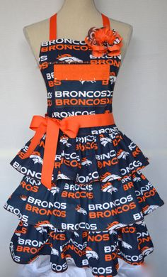 How about those Broncos!! This adorable triple ruffled apron is just perfect to show off your team spirit...3 layers of Bronco print on sewn onto