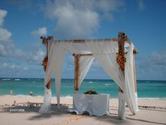 Beach wedding gazebo with sheer draping
