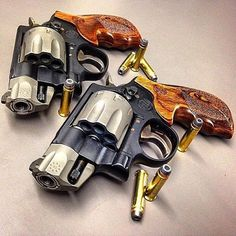 Set of Smith &Wesson 8 shot revolvers in .327 & .357 mag. Find our speedloader now! http://www.amazon.com/shops/raeind