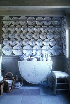From a Swedish manor, kitchen in 17th century style... What I love about this is the built in plate rack... awesome.