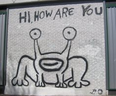 """Jeremiah the Innocent:   Hello Frog, Art. Austin, TX. This art painting is a landmark for native Austin born Texans.   Daniel Johnston created an Austin landmark in 1993, when he painted a mural of the """"Hi, How Are You?"""" frog - also known as """"Jeremiah the Innocent"""" - on the side of Sound Exchange in Austin, Texas.  Locals have successfully preserved the image when the building changed ownership."""