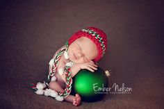 Christmas baby - see why you need a giant ornament!  Photo Session Ideas | Props | Prop | Newborn Photography | Christmas Card Inspiration | Pose Idea | Poses |Christmas Ornaments for Photo Prop
