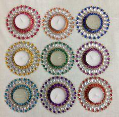 A set of nine colorful kundan diyas Diwali Diya, Diwali Craft, Diwali Gifts, Diy Diwali Decorations, Festival Decorations, Recycled Cd Crafts, Diya Designs, Acrylic Rangoli, Beaded Mirror