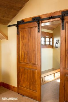 Byparting barn door hardware adds a touch of elegance in this room.  http://rusticahardware.com/bi-parting-barn-door-hardware-system/