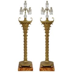 An Pair of Regency Giltwood Torchieres with Regency Candelabra. England. (1810)