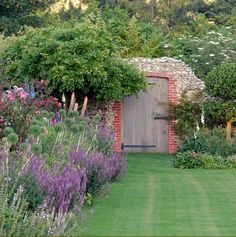 A garden in Norfolk for an Elizabethan hall. Arriving at this extraordinary, romantic hall in north Norfolk we found only minimal remains of the Tudor garden which we know once existed. Our brief was not to re-create those gardens but to design something new, which had echoes of its history. (Arne Maynard)