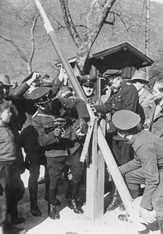 German and Austrian border police dismantle a border post on March 15, 1938.