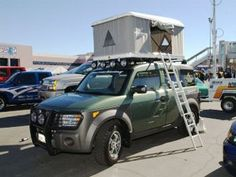 Honda Element with roof top tent & Tent and Kelty Carport awning on my Honda Element | Car Camping ...