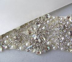 Swarovski Crystal & Pearl Sash Rhinestone Bridal by TheRedMagnolia @CourtneyBeth13 - this popped up on my Easy and made me think of you!