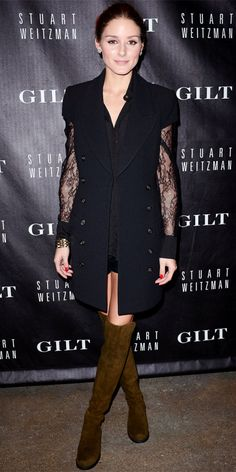 Oliva Palermo sported chic Stuart Weirzman over-the-knee boots with a long-sleeve lace blouse, short shorts, a gold cuff and a short-sleeve tuxedo topper.