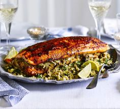 Roast whole sides of salmon with Middle Eastern spices and serve with tangy citrus and currant couscous - perfect for feeding a crowd