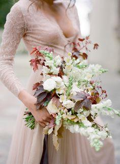 Anemone, ranunculus, and bold mahogany leave wedding bouquet: http://www.stylemepretty.com/2016/10/01/blush-pink-wedding-dresses/ Photography: Jose Villa - http://josevilla.com/