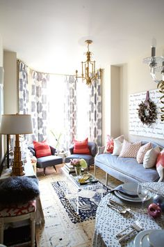 Long, Narrow Living Room (layout) with blue sofa opposite console table and pops of coral - Holiday Home Tour 2011 Meredith Heron, HGTV Canada