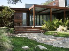 gorgeous wood façade with covered porch, modern front of house, love it
