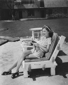 Barbara Stanwyck knitting on the beach