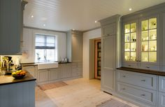 Hand painted light gray kitchen in solid pine from Os Trekultur. Worktop in stained and varnished oak. Large double porcelain sink. Integrated appliances and good storage solutions.