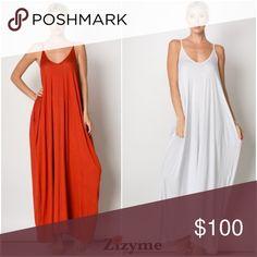 🛒• Harem Side Pocket Detailed Dress• Harem Side Pocket Detailed Dress * Color: White,Black ,Denim Blue, Rust. * 💋Price is firm💋  Price per piece  Fabric: RAYON, SPANDEX  Content: 95% RAYON 5% SPANDEX Dresses Maxi