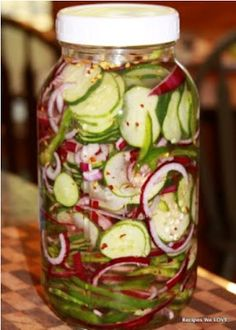 Refrig. cucumber salad Mix cucumbers, onions, peppers and salt; set aside.      Put vinegar, sugar, celery flakes and pepper flakes in a pot and bring to a boil.       Remove from heat and add 2 handfuls of ice until melted.      Place all veggies in large mouth canning jars (2 quarts or 1 half gallon jar).      Pour mixture over cucumbers.      Store in refrigerator.