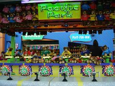 Top Glow: Get ready, set and go! Aim your water gun into a spinning hole and spiral your toy to the top. First one t the top wins a prize! There's a winner every race!    Visit the Pacific Park website at www.pacpark.com