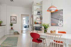 A gorgeous Swedish apartment...so IKEA...love the mismatched chairs.