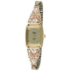 Coleman Black Hills Gold 10K Gold Butterfly Watch. Elegance with a touch of whimsy. 10K yellow gold butterfly wings adorned with colorful 12K gold rose-and-green leaves. Gold face with diamond accent